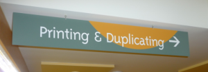 Printing Duplicating Sign by door